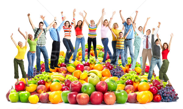 Stock photo: Group of happy people with fruits.