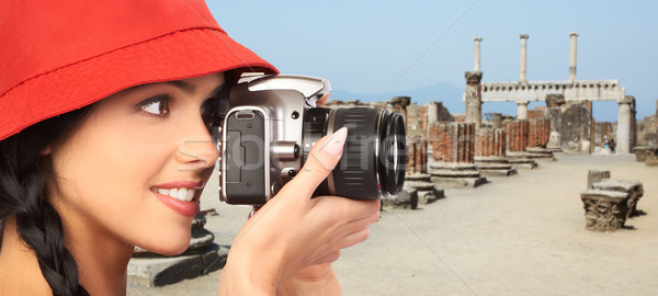 Tourist woman with a camera. Stock photo © Kurhan