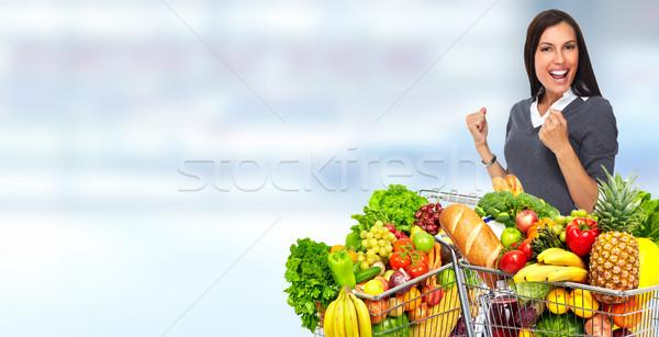 Boldog fiatal nő élelmiszer bevásárlókocsi kék absztrakt Stock fotó © Kurhan