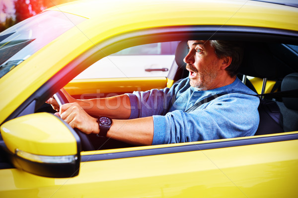 Stressed car driver man having accident on road. Stock photo © Kurhan
