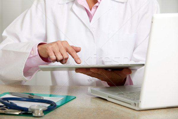 Doctor woman hands with tablet computer. Stock photo © Kurhan
