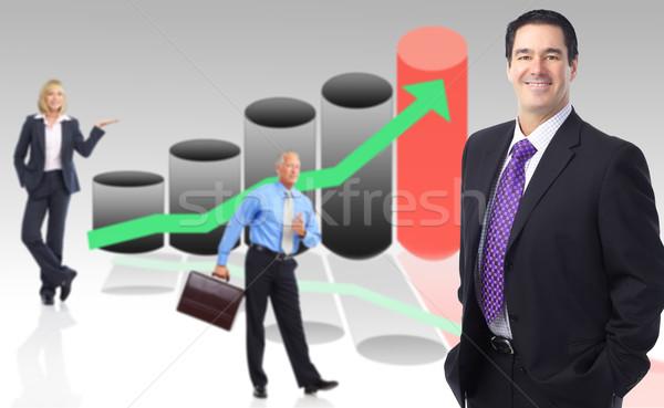 Zakenlieden team grafiek vrouw glimlach man Stockfoto © Kurhan
