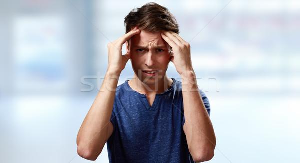 Dor de cabeça deprimido homem azul cara estudante Foto stock © Kurhan