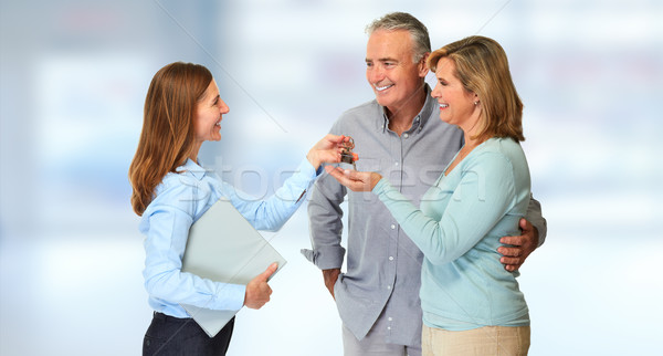 Senior couple with estate agent Stock photo © Kurhan