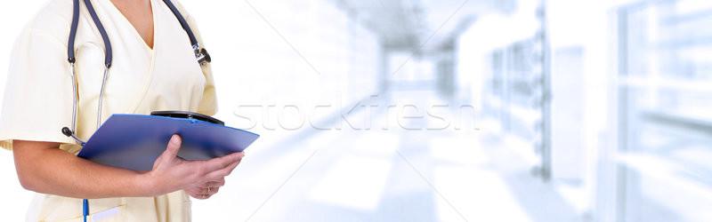 Doctor hands writing on clipboard Stock photo © Kurhan