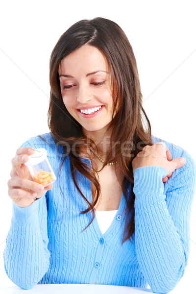 Woman with pills Stock photo © Kurhan