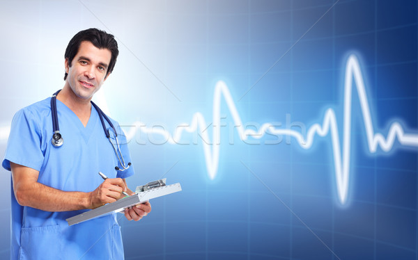 Medical doctor cardiologist. Over cardio background. Stock photo © Kurhan