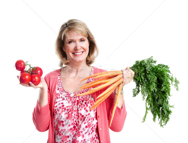 Senior woman with vegetables. Stock photo © Kurhan