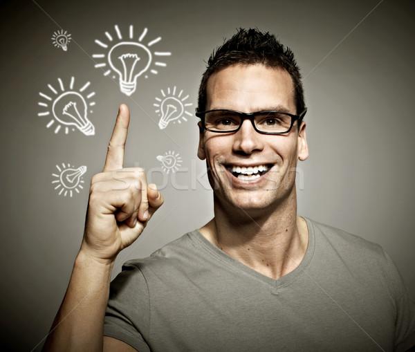 Giovane idea successo sorriso uomo occhiali Foto d'archivio © Kurhan