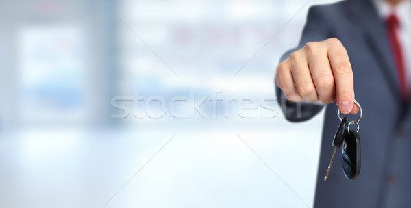 Car dealer hand with a key. Stock photo © Kurhan