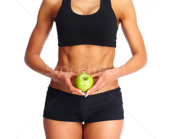 Young fitness woman abdomen with apple. Stock photo © Kurhan