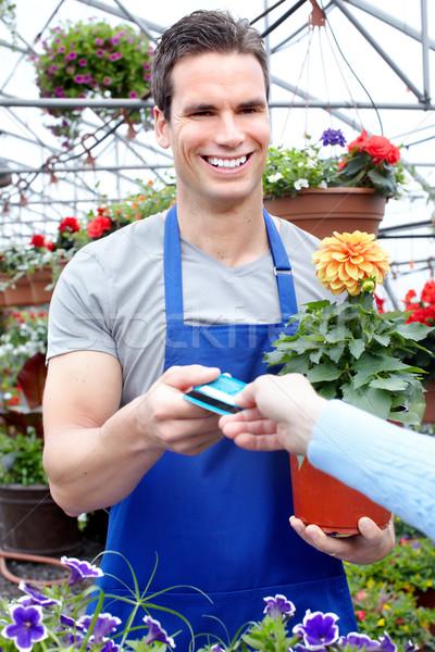 ガーデニング 小さな 笑みを浮かべて 販売者 花屋 作業 ストックフォト © Kurhan