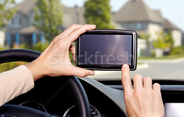 Samochodu kierowcy ręce GPS drogowego cel Zdjęcia stock © Kurhan