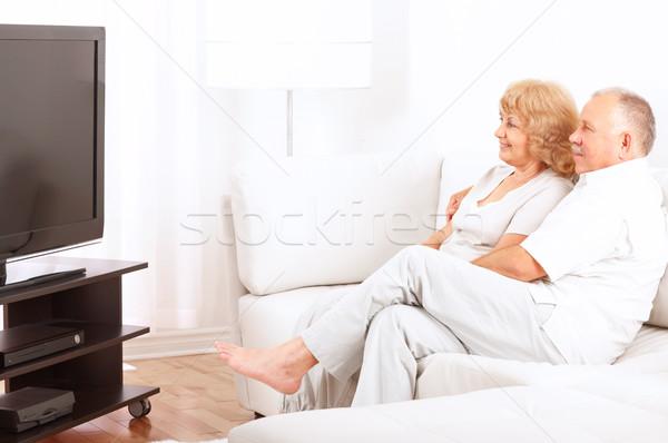 Anziani Coppia felice sorridere guardare tv Foto d'archivio © Kurhan