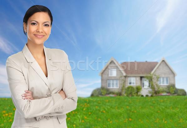 Beautiful asian woman near new house. Stock photo © Kurhan