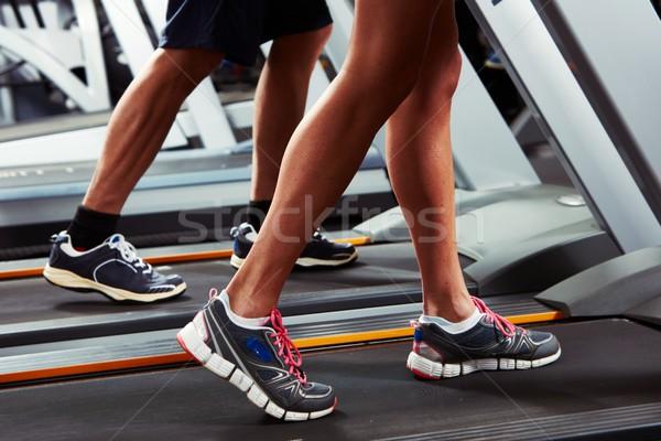 Legs on treadmill Stock photo © Kurhan