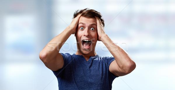 Happy surprised young man Stock photo © Kurhan