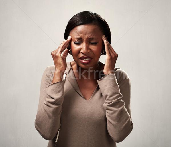 Dolor de cabeza mujer migraña gris manos Foto stock © Kurhan
