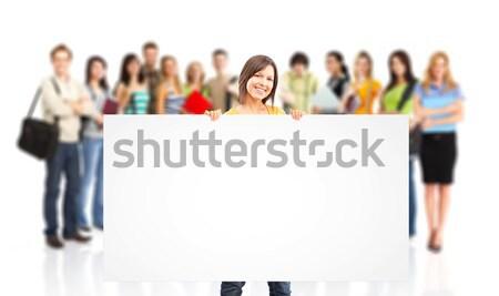 Diákok nagyobb csoport mosolyog izolált fehér nő Stock fotó © Kurhan