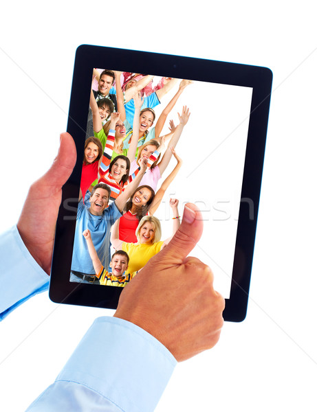 Tablet computer and group of happy people. Stock photo © Kurhan