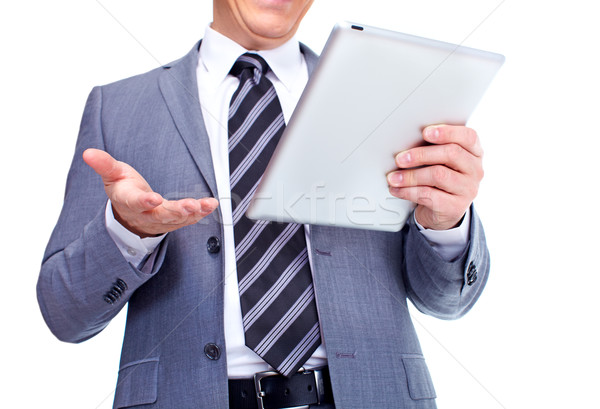 Hands of businessman with tablet computer. Stock photo © Kurhan
