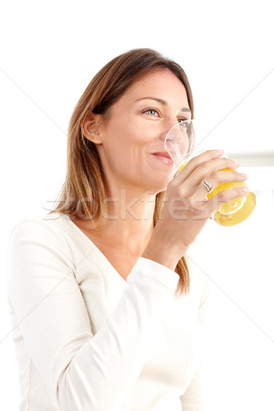 Vrouw sap mooie glimlachende vrouw drinken sinaasappelsap Stockfoto © Kurhan