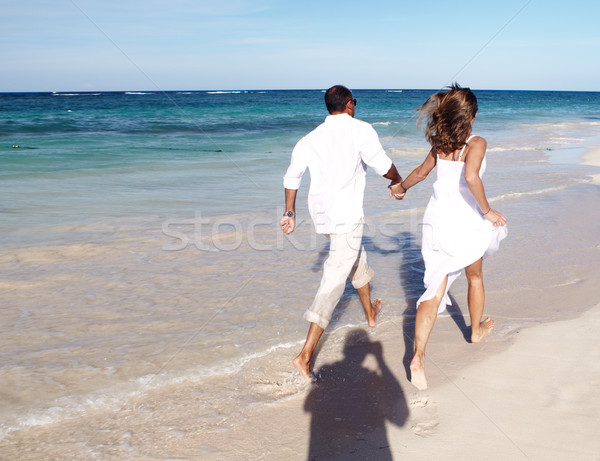 Casal corrida praia feliz caribbean férias Foto stock © Kurhan