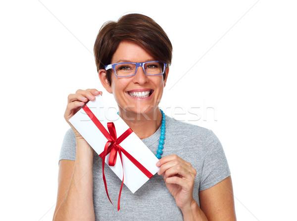 Beautiful shopping woman with envelope gift. Stock photo © Kurhan
