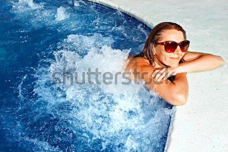 Donna piscina bella donna rilassante piscina vacanze Foto d'archivio © Kurhan