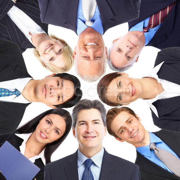 Zakenlieden team glimlachend teamwerk business Stockfoto © Kurhan