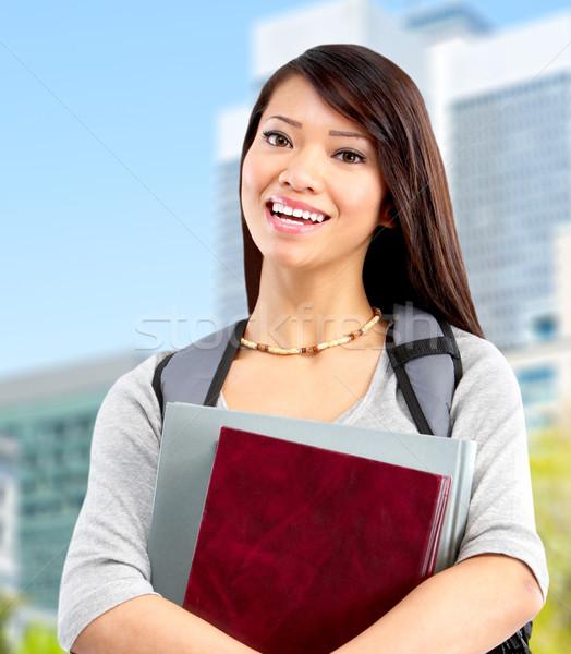 Jungen Studenten Frau lächelnd Buch Universität Stock foto © Kurhan
