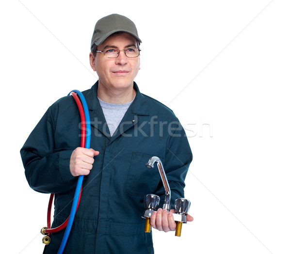 Plumber with faucet. Stock photo © Kurhan