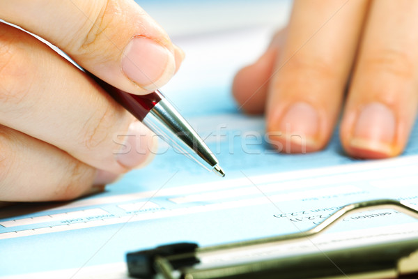 Stock photo: Business woman filling document.