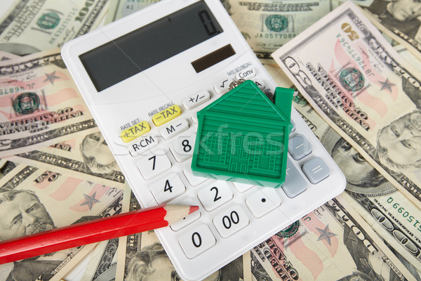 House money and calculator. Stock photo © Kurhan
