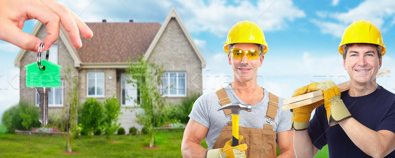 Stock photo: Group of construction workers. House renovation.