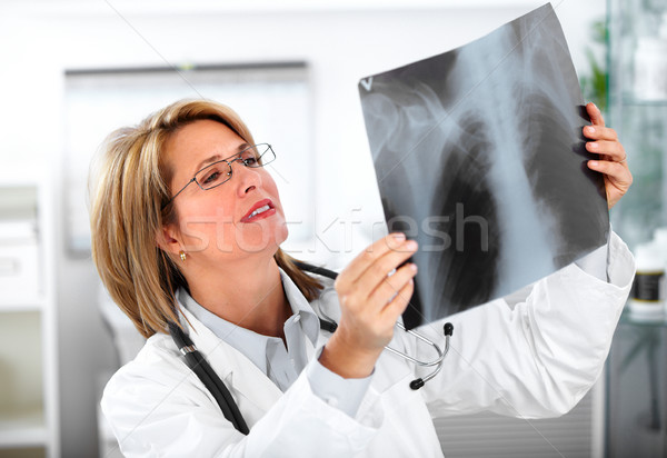 Mature doctor woman with a X-ray photograph. Stock photo © Kurhan