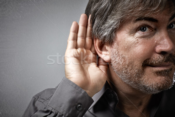 Hand and ear of eavesdropping listening man. Stock photo © Kurhan