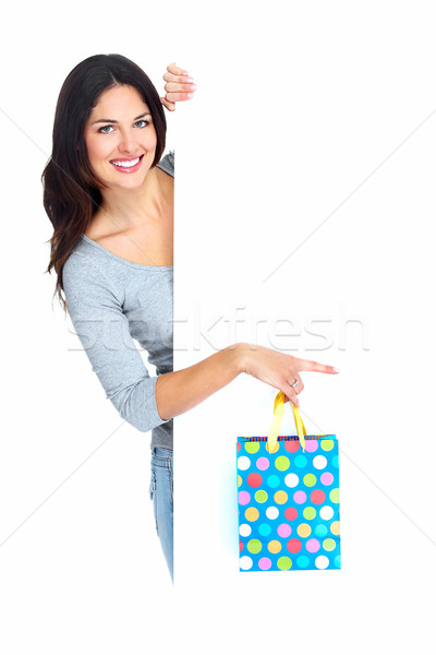 Beautiful shopping Christmas woman with bag. Stock photo © Kurhan