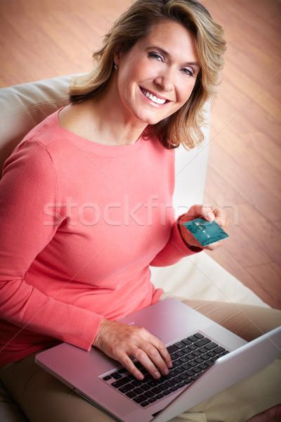 Woman with laptop and a credit card. Stock photo © Kurhan
