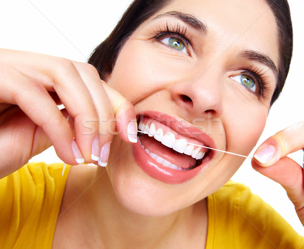 Mooie vrouw flosdraad tandarts gezondheidszorg kliniek glimlach Stockfoto © Kurhan