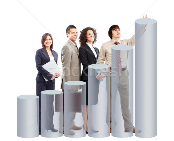 Stockfoto: Zakenlieden · team · grafiek · geïsoleerd · witte · glimlach