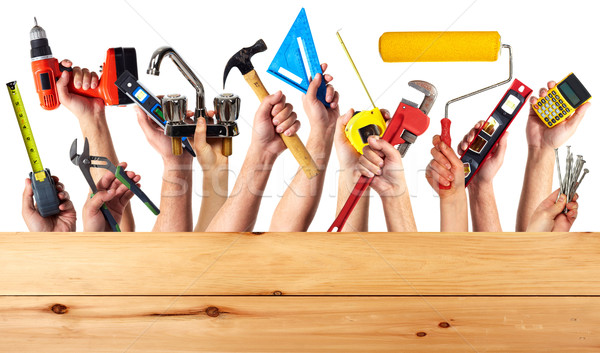 Hands with construction tools. Stock photo © Kurhan