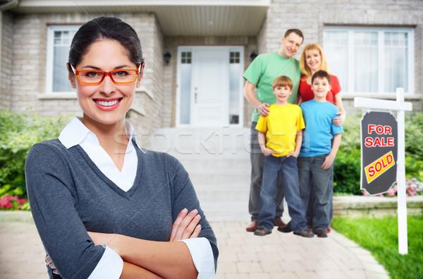 Happy family near new house. Stock photo © Kurhan