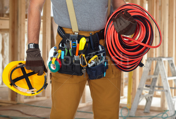 Electrician with construction tools and cable. Stock photo © Kurhan