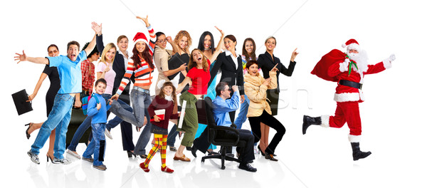 Running Santa and a group of happy people. Stock photo © Kurhan