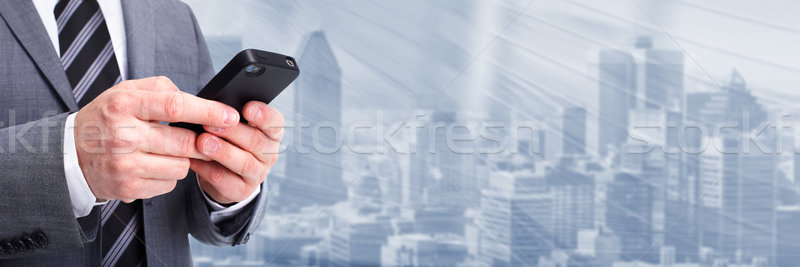 Businessman calling by phone. Stock photo © Kurhan