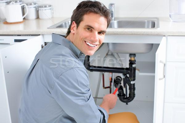 водопроводчика молодые раковина человека счастливым Сток-фото © Kurhan