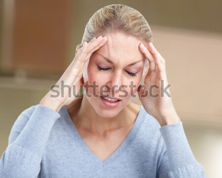 Senior woman having a migraine headache. Stock photo © Kurhan