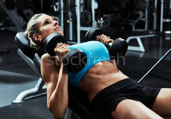 Bench press workout Stock photo © Kurhan