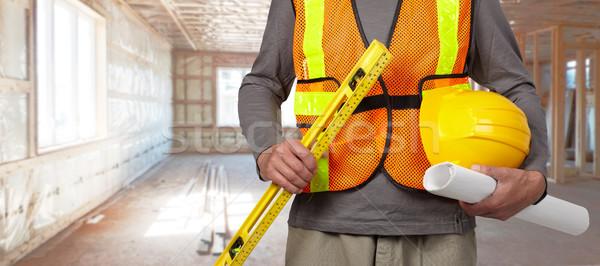 Travailleur casque orange sécurité gilet travailleur de la construction Photo stock © Kurhan